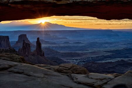 Sunrise behind Mesa Arch at Canyonlands National Park, Iceland in the Sky, Moab, Utah, USA, North America