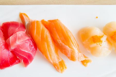 hotate: A salmon tuna and hotate sushi on white plate. Stock Photo