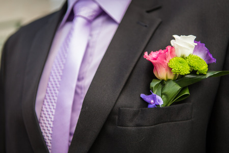 Groom with flower in the lapel of his jacket  photo