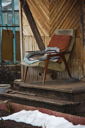 old chair on the doorstep in the early spring photo