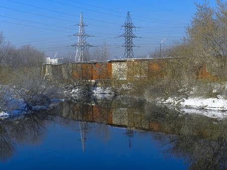 River in winter with a view of the slums photo