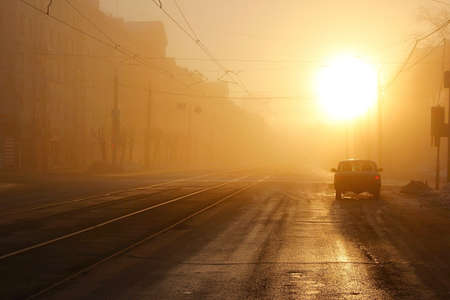 street in the fog of the morning in the sun