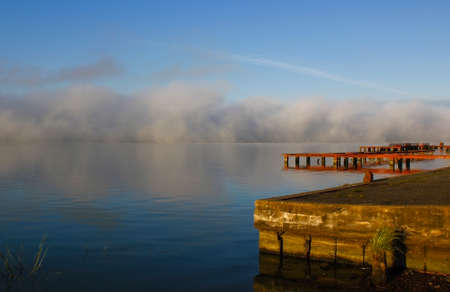 pond embankment in the morning with a wall of fog Stock Photo
