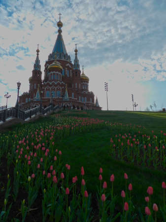 Orthodox church with blooming tulips