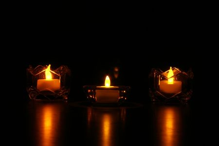 three battery powered candles