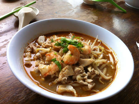 A bowl of sumptous and delicious laksa with prawns in Sarawak. Stock Photo - 20710256