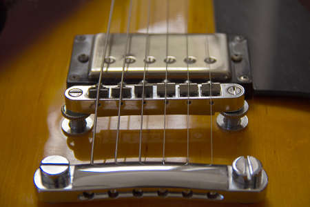 Closeup of electro-guitar bridge photo