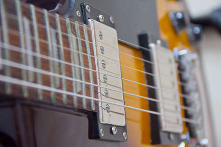 e guitar: Electric guitar body, strings and buttons Stock Photo