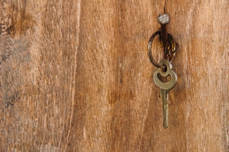 key with wood background photo