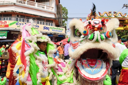 Nakhon Sawan, Thailand - February 6,2011 -  acrobatic lion dancers show with the crowd in chinese new year celebration