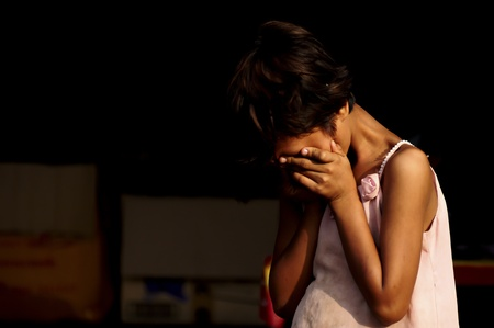 Sangklaburi, Thailand - May 10,2010 -  abandoned dirty child crying Stock Photo - 9638135
