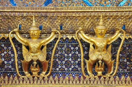 The Garuda and gold textured at Wat Phra Kaew, The Emerald Buddha temple, Bangkok, Thailand photo