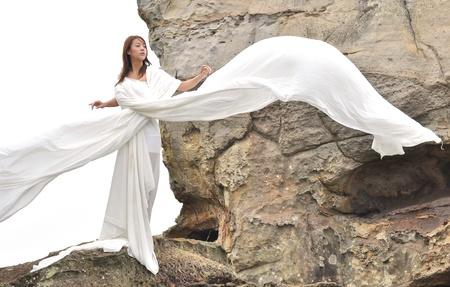 attractive woman in white dress looks like angel Stock Photo - 10130992