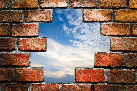 cement wall: Blue sky in ancient brick wall