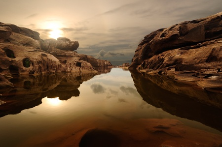 river stones: sunrise head dog at Sam Phan Bhok Grand Canyon, Mekhong river, Ubon Ratchathani, Thailand