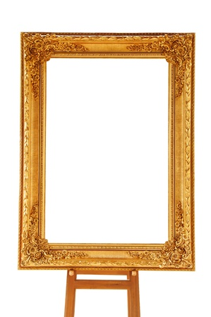 Vintage gold picture frame with wooden easel isolated on white background photo