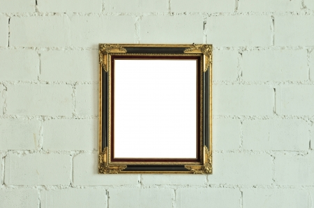 Vintage gold picture frame on white wall Stock Photo