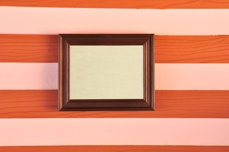 Wooden picture frame on the wall Stock Photo - 11498551