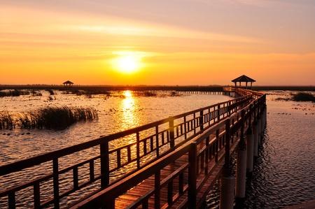 Boardwalk on the lake at sunset, Sam Roi Yod National Park, Prachuap Khiri Khan, Thailand Stock Photo
