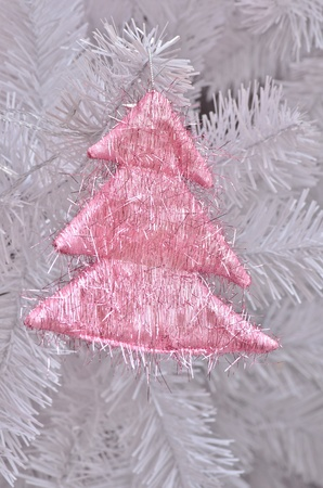 Pink christmas tree on christmas tree photo