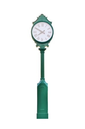 metal pole: An old exterior clock on white