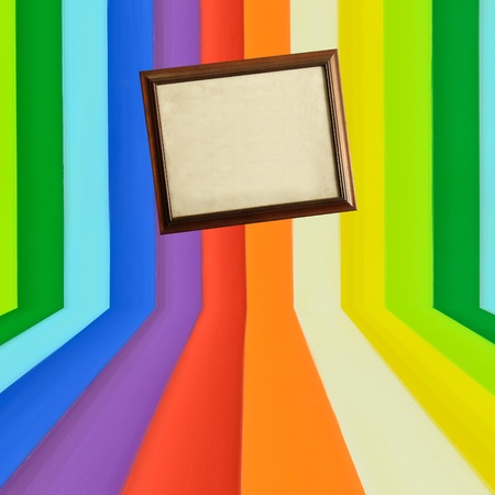 plotting: Vintage wooden picture frame on creative colorful wall