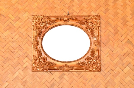 Vintage picture frame on woven wood wall Stock Photo - 12179188