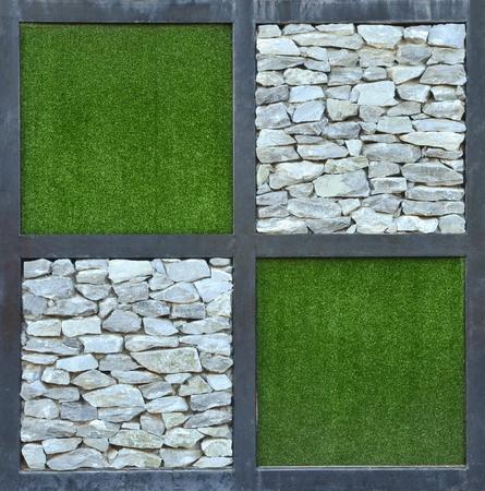 grass and stone wall background Standard-Bild