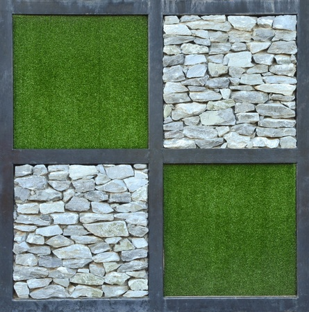 grass and stone wall background Stock Photo