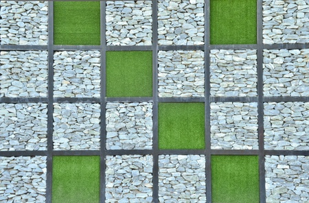 grass and stone wall background photo