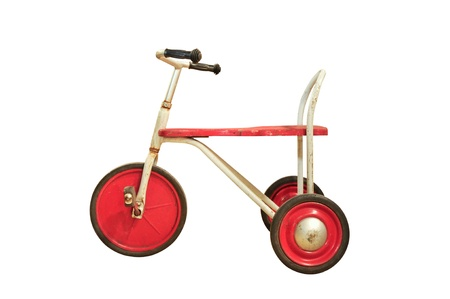Vintage red tricycle isolated on white photo