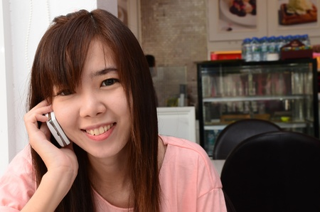 Happy girl smiling and speaking telephone Stock Photo - 13047092