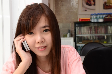 Happy girl smiling and speaking telephone Stock Photo - 13061119