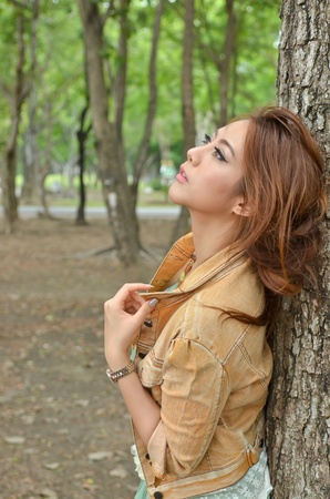 Beautiful pensive girl looking up Stock Photo - 13208381