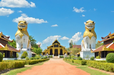 two lions with ancient building at Surasri Camp, Kanchanaburi, Thailand Stock Photo - 13208450