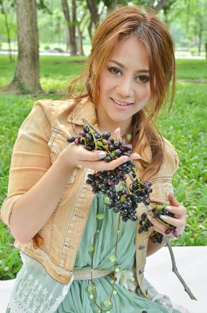 Beautiful woman eat fruit in the park Stock Photo - 13235061