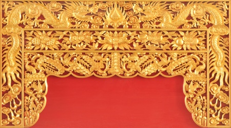 Gold dragon on the red wall  photo