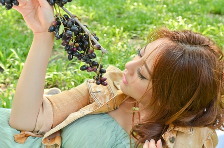Beautiful woman eat fruit in the park Stock Photo - 13422706
