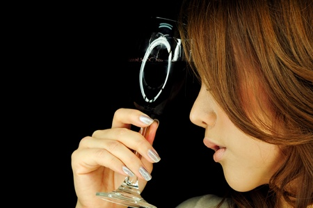Beautiful woman with wine glass in hand photo