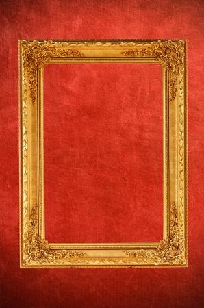 Vintage gold picture frame on vintage red background