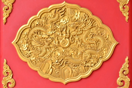Gold dragon texture on Thai temple wall photo