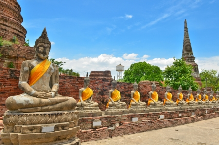 Ancient buddha statues with blue sky at Wat Yai Chaimongkol, Ayutthaya, Thailand  photo