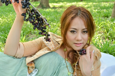 Beautiful woman eat fruit in the park Stock Photo - 13831305