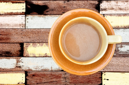 Coffee cup on vintage wood background photo