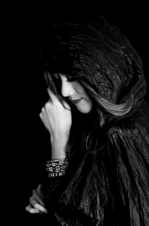 Mysterious portrait of young beautiful woman in the black dress Stock Photo - 14158503