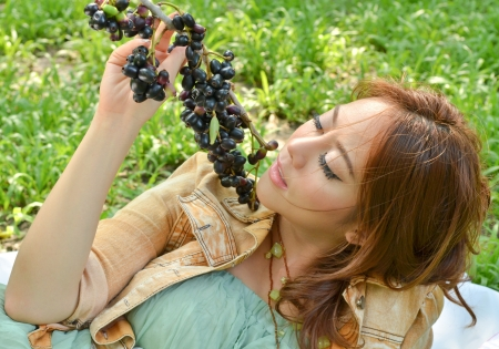 Beautiful woman eat fruit in the park Stock Photo - 14158540