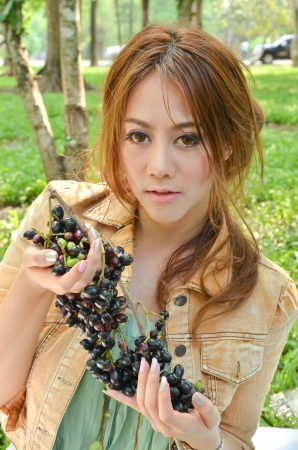 Beautiful woman eat fruit in the park Stock Photo - 14158548