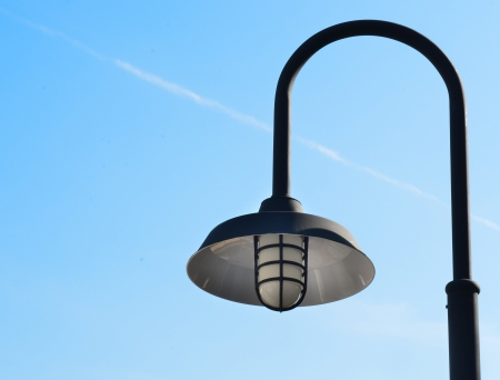 Vintage street lamp and blue sky photo