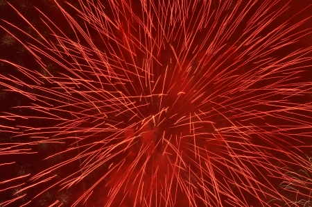 red firework in night sky photo