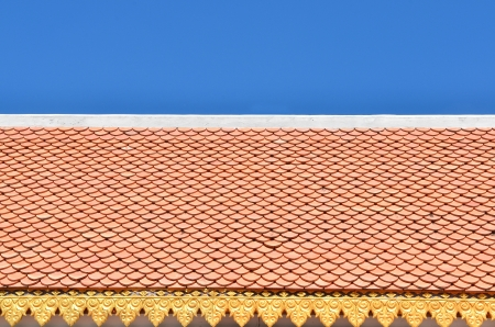 color roof tiles pattern with blue sky photo